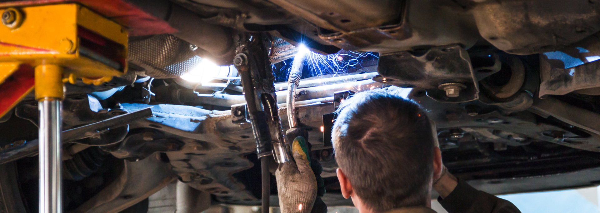 Mechanic welding a vehicle - Car Repairs Wrexham